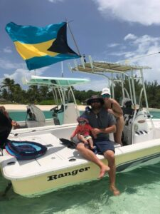 Charles' son and family on his Ranger boat